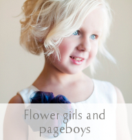 Picutre of a tiny girl in a lovely Gilly Gray chiffon flowergirl dress