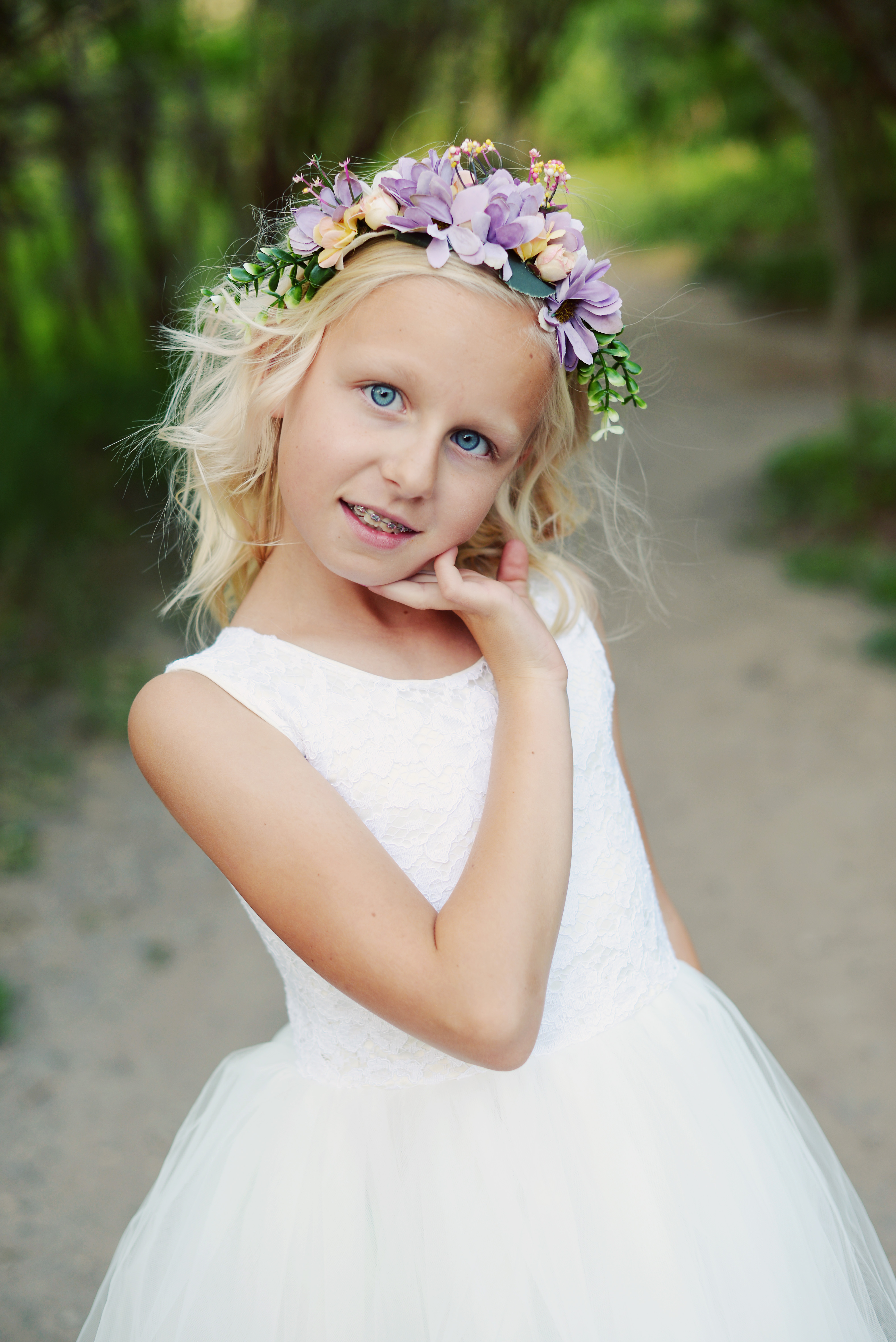 Team this pretty purple floral headband with any of our flower girl dresses. 2778521bb85
