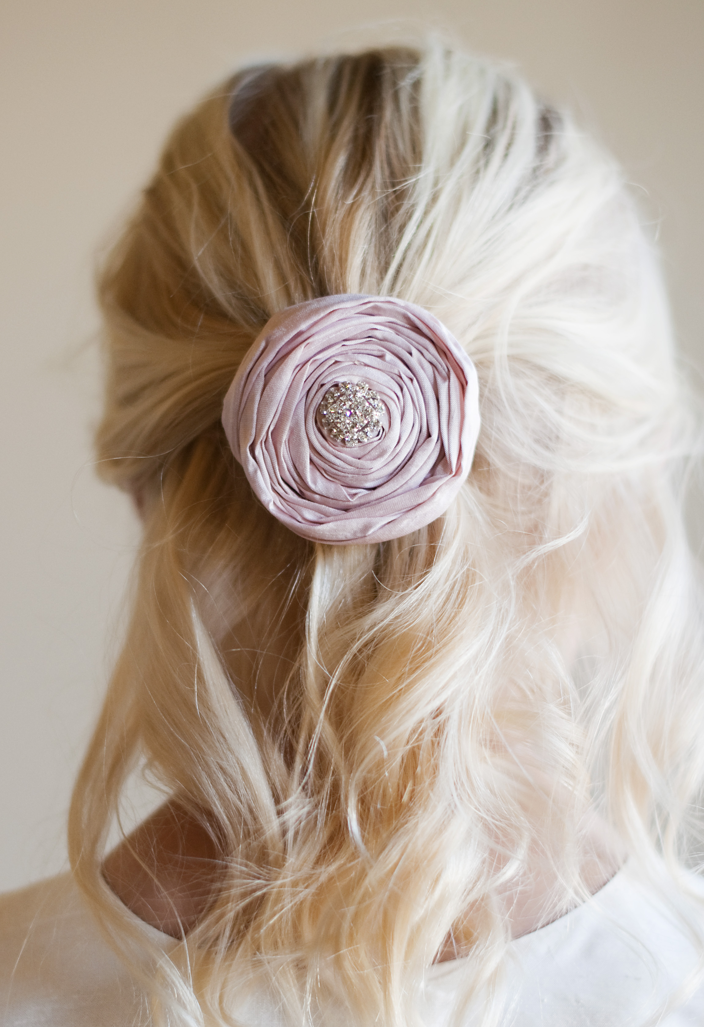 A silk hairclip with diamante detail in all colours