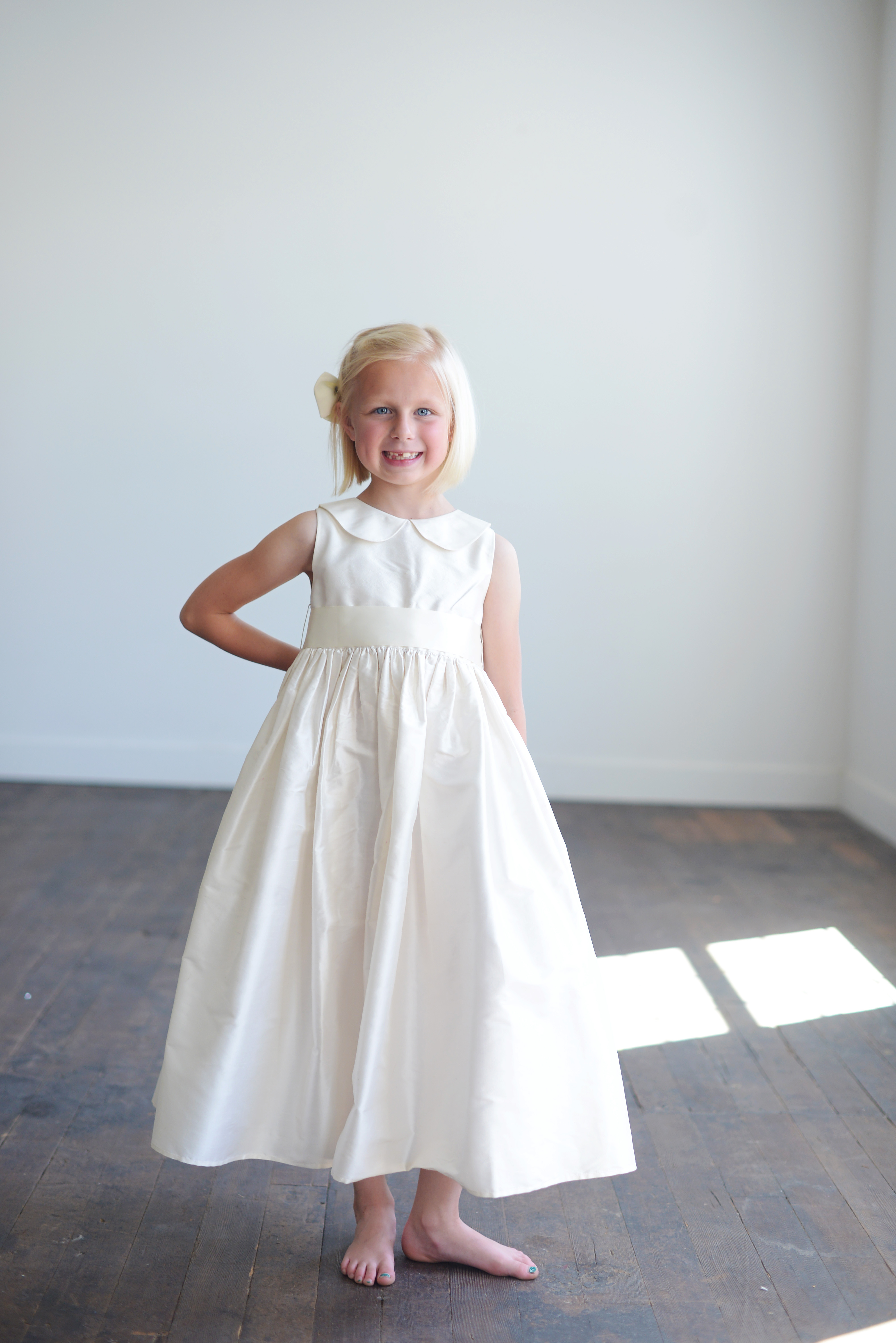 A Collection Of Very Pretty Flower Girl Dresses In Ivory Or White