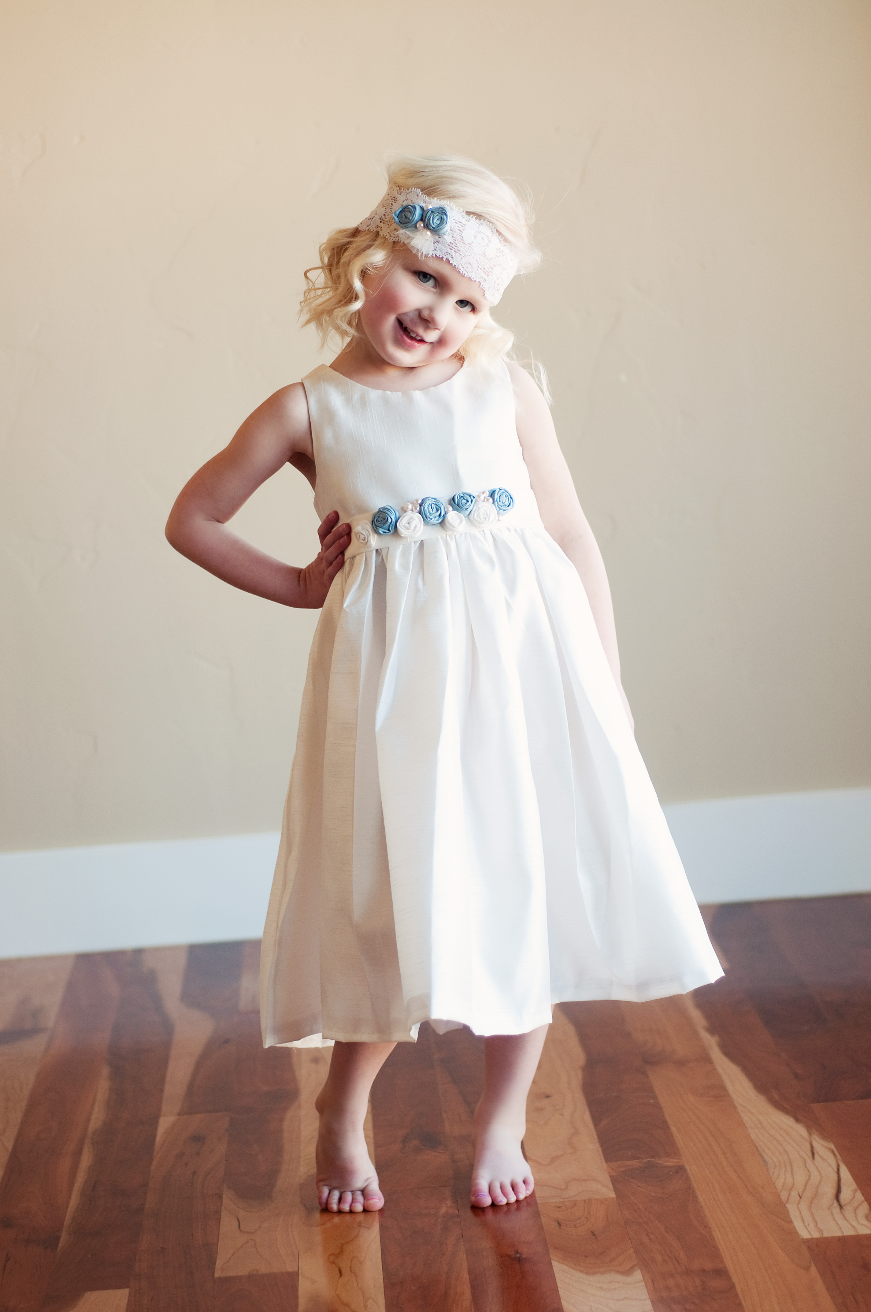 Beautiful flower girl dresses made by hand at reasonable prices in forget me not flower girl dress is handmade to measure in ivory or white with the pretty silk flowers available in 140 colours izmirmasajfo