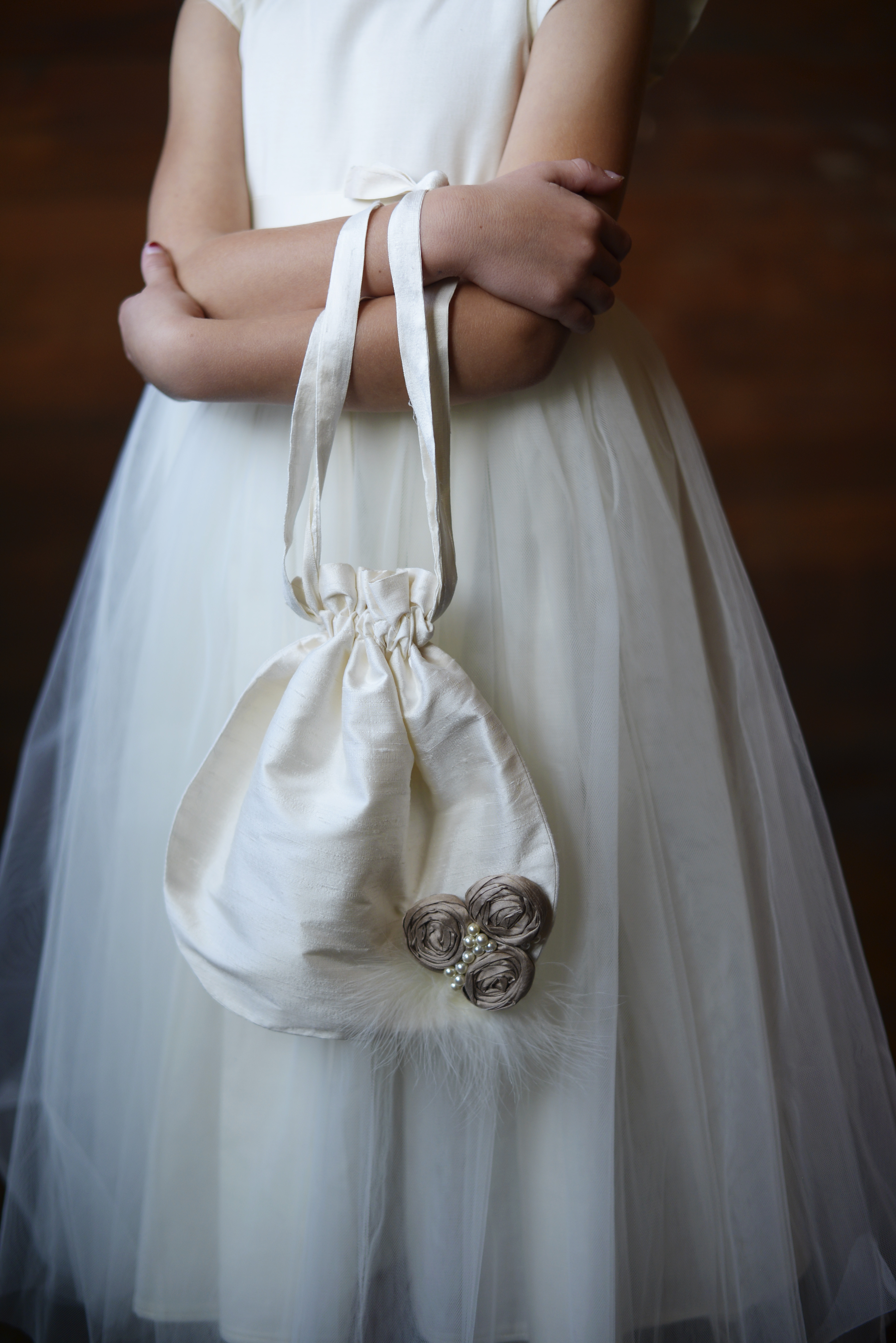 70f9f74f285 An ivory silk flower girl bag with silk roses and pearls teamed with an  ivory tulle flower girl dress.