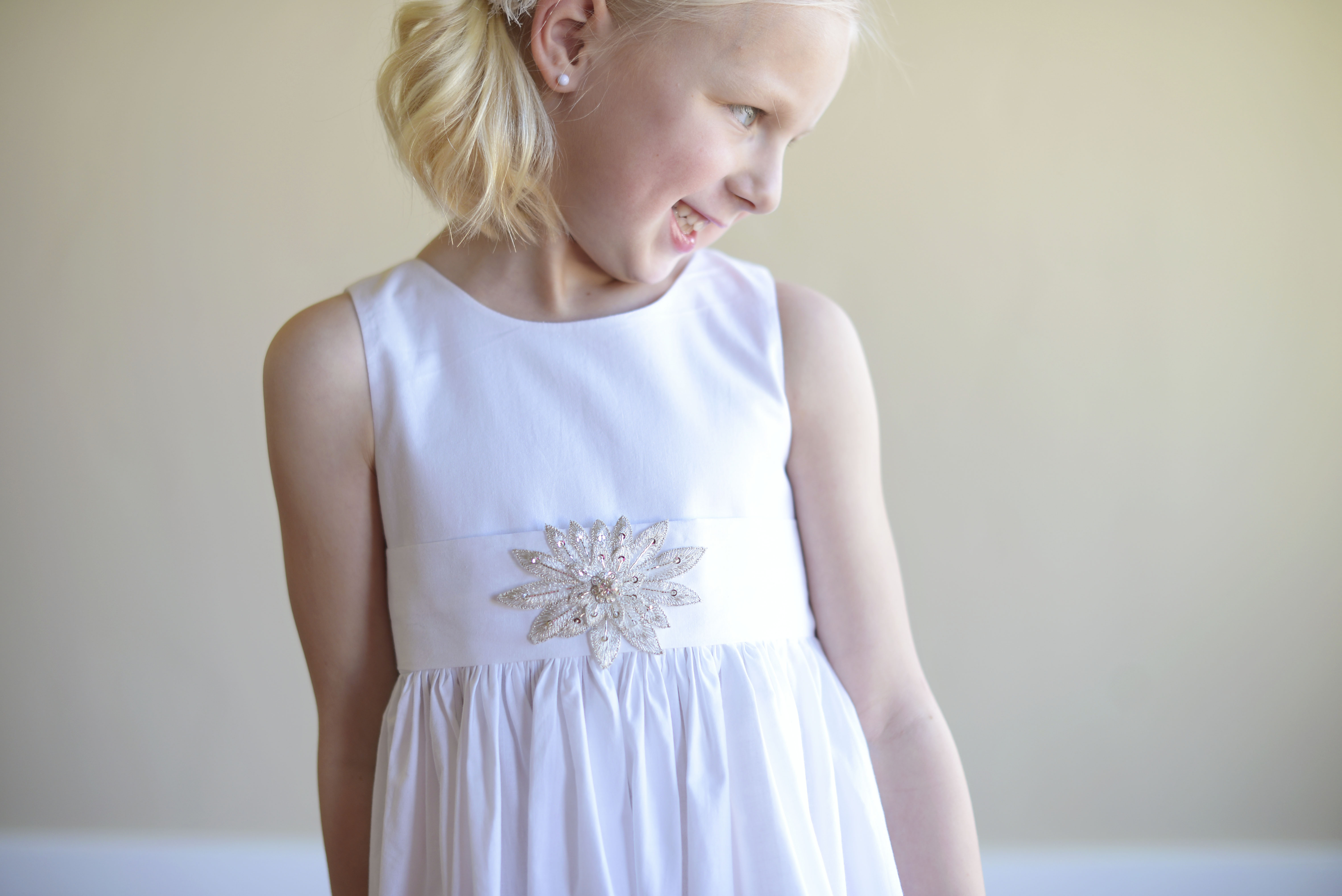 Adorable flower girl dresses and first communion dresses made in the uk the summer flower girl dress is a white or ivory cotton first communion dress in cotton with a diamant star motif mightylinksfo