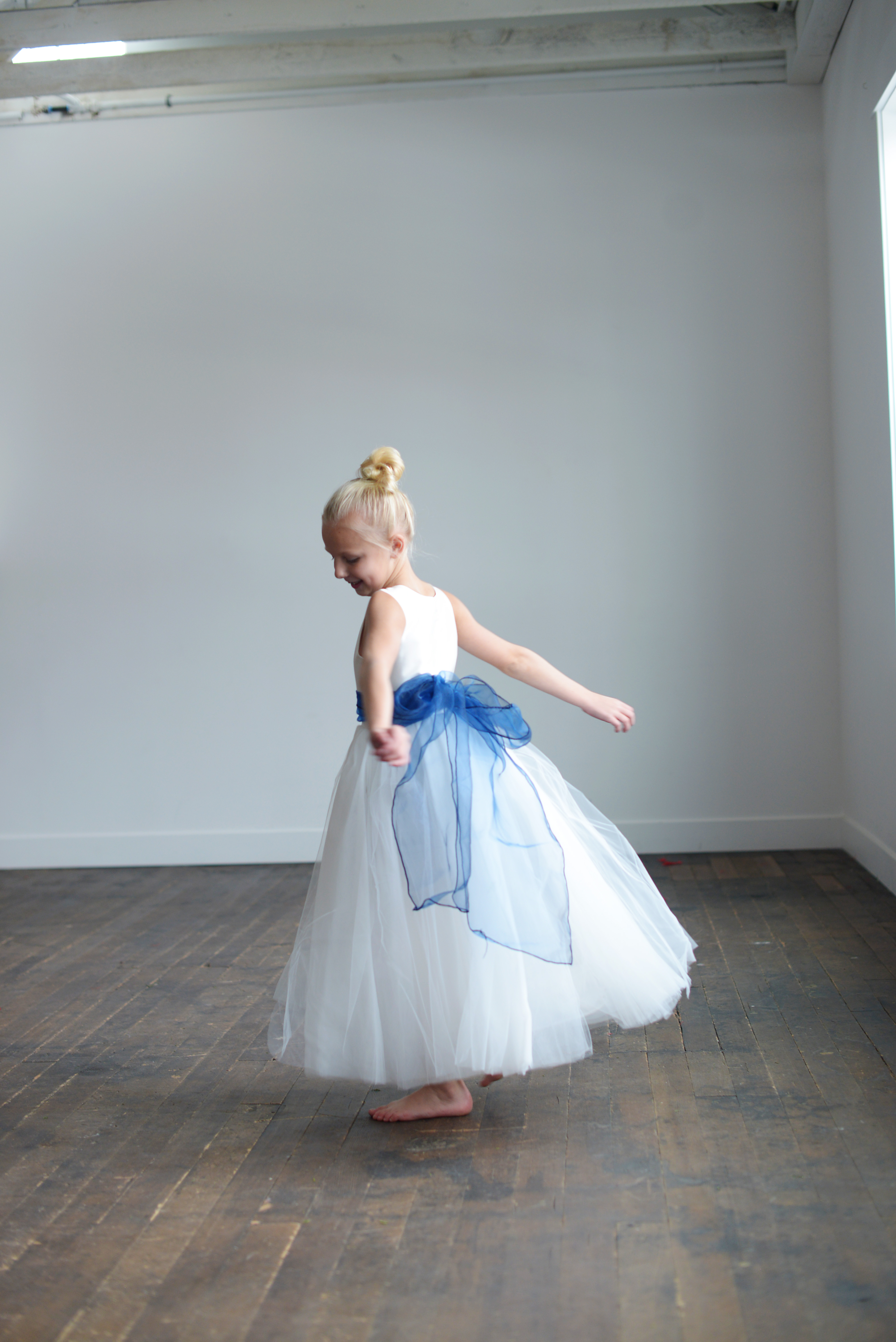 Our range of gorgeous affordable handmade baby toddler flower girl the blue organza flower girl dress with the sash available in many colours izmirmasajfo