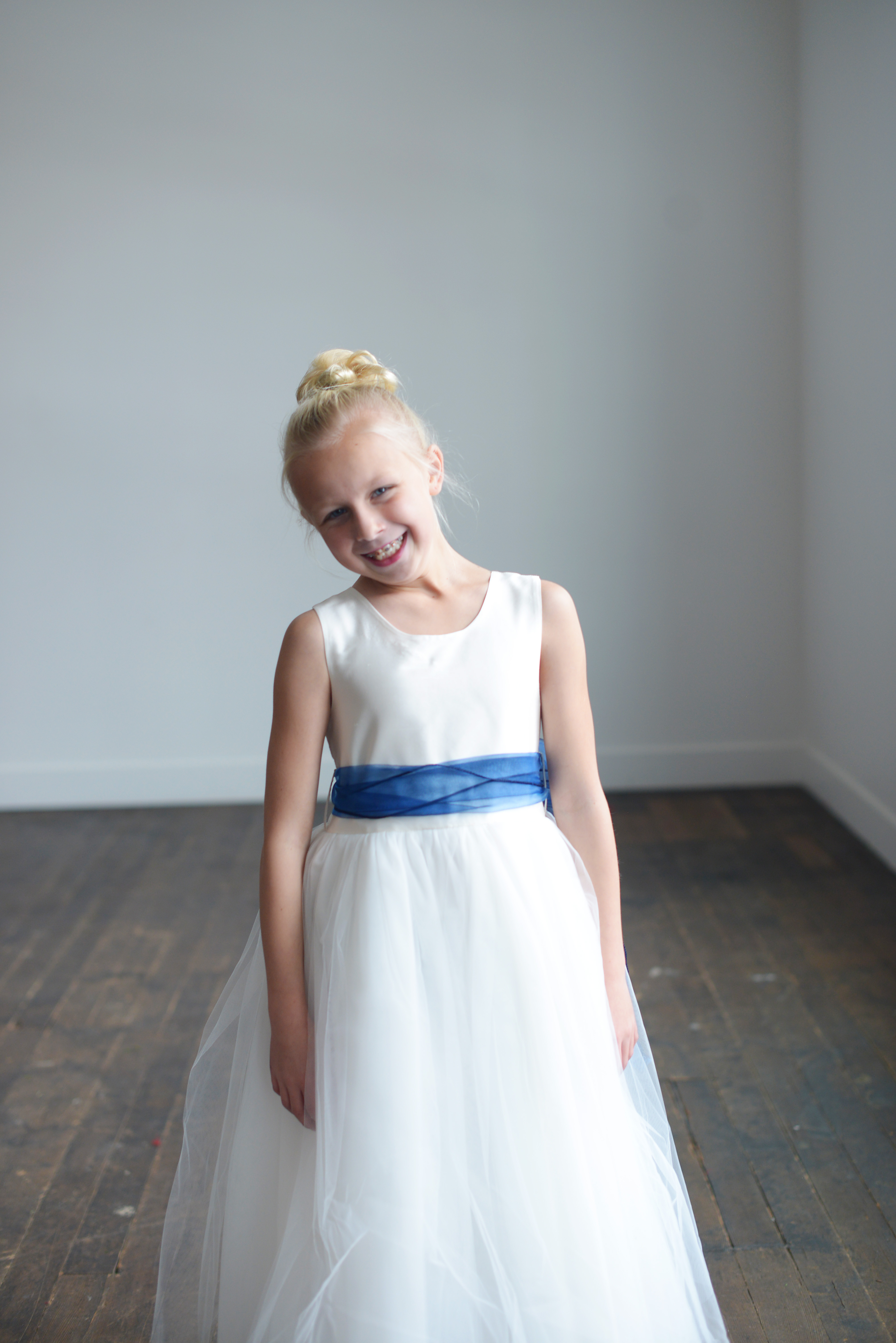 Our range of gorgeous affordable handmade baby toddler flower girl the blue organza flower girl dress available in ivory and white with sashes in many colours izmirmasajfo