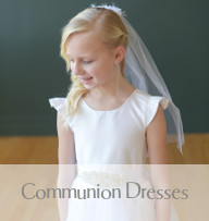 Picture of a beautiful little girl wearing a Gilly Gray handmade dress for her first communion