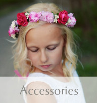 Picture of a beautiful girl wearing a Gilly Gray lace headband with silk peony decoration