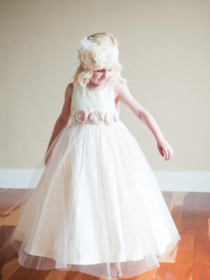 a blush pink flower girl dress with tulle in a victorian stlye for bridesmaids