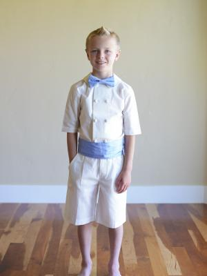 a photo of boys french shorts and peter pan collar shirt in ivory or white