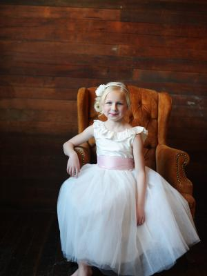 a ruffle collar ballerina length flower girl dress in ovory and pink