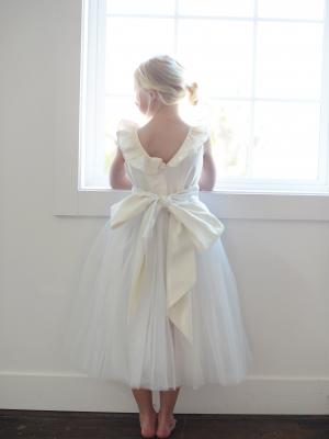 a ruffle neck flower girl dress or junior bridesmaid dress in ivory and tulle