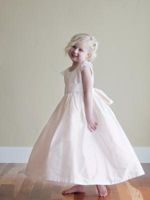 A photo of a made to measure pink silk flower girl dress
