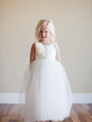 a made to measure peony silk flower girl dress in ivory silk and tulle