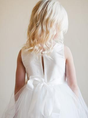a photo of a made to measure flower girl dress with high quality silk and tulle