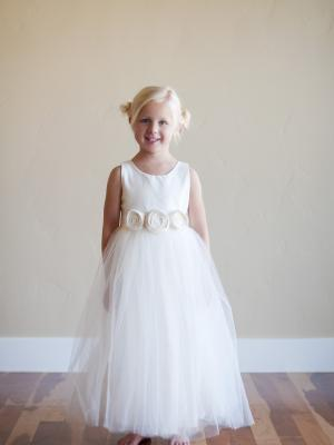 A photo of a cotton and tulle flower girl dress
