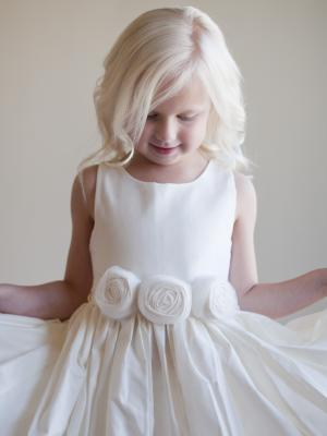 A photo of a cream cotton flower girl dress in ivory or white for rustic wedding
