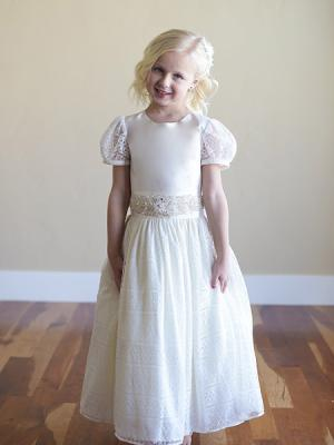 A flower girl dress with silk top, lined lace skirt, petticoat and lace sleeves