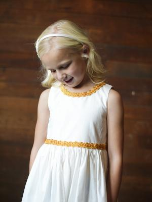 Flower girl dress made with cotton and gold brocade