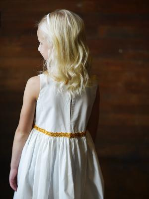 The back of the Hera dress with gold brocade details