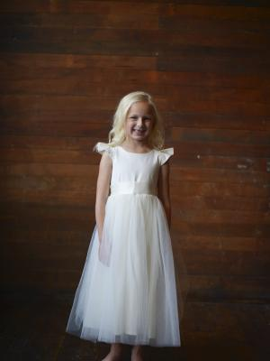 a junior bridesmaid dress with tulle skirt and cap sleeves