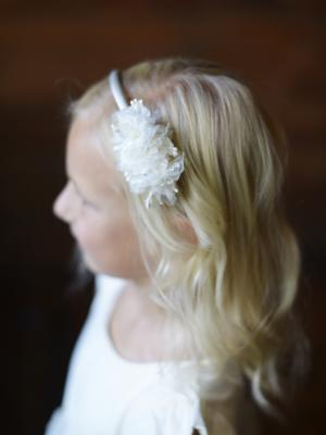 ivory or white headband with flower details for a wedding or communion