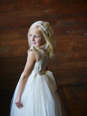a flower girl dress with cap sleeves perfect for beach wedding