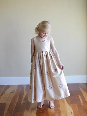 An embriodered blush silk flower girl dress