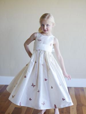 A white silk girls flower girl dress