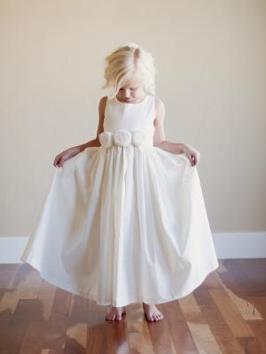 a photo of an ivory flower girl dress for a beach wedding or rustic wedding