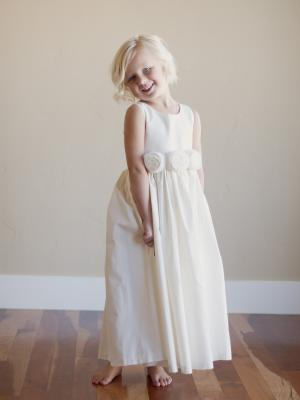 a floor length f lower girl dress in ivory or white for beach wedding