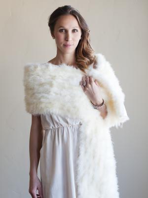 A photo of an ivory wedding shawl