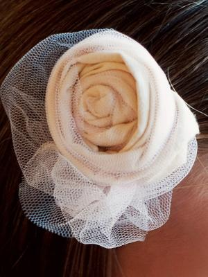 A photo of a cotton rose hairclip with tulle