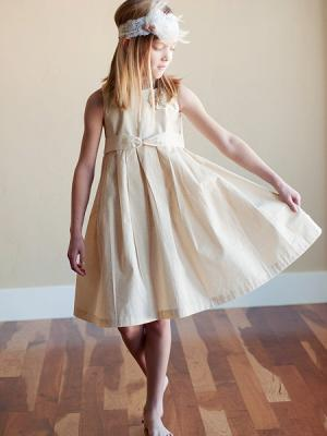 A photo of a made to measure flower girl dress in pure cotton