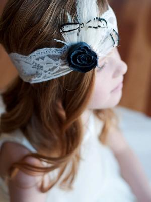 A photoof a 1920s vintage style headband in black and white