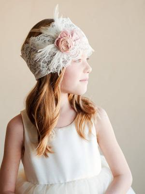 A photo of a vintage style lace and silk headband