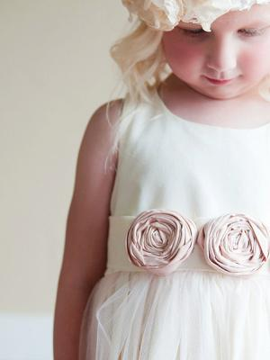 a traditional ivory flower girl dress with blush pink flowers an original dress