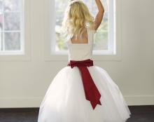 an ivory flower girl skirt in ballerina style with ruby red sash belt