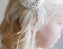 A photo of a pure silk hair clip for flower girls with rhinestone detail
