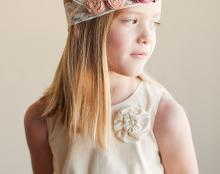 A photo of a simple rustic cotton flower girl dress
