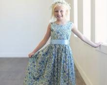 a daisy flower girl dress in blue cotton and a blue ribbon belt