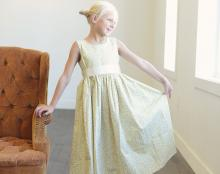 a lemon yellow floral flower girl dress in pure cotton