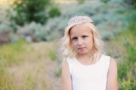 A girl wearing a  diamanté hair crown for first communion