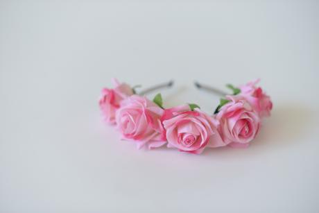 A close up of a pink rose flower girl hair band with pink roses perfectly matched to our flower girl dresses