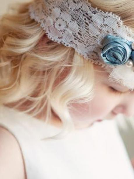 A handmade pearl blue and white lace headband with flowers