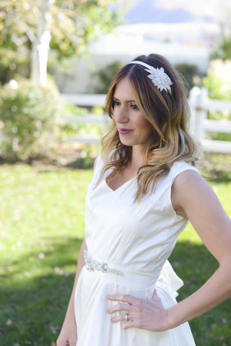 A bridesmaid wearing a diamante bridal star headband on a satin Alice band.