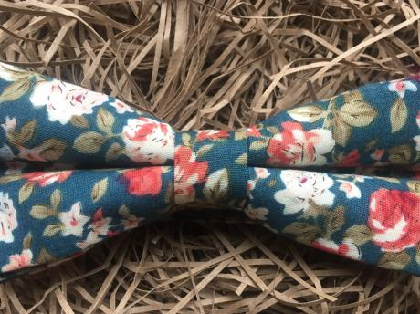 Floral pre-tied bow tie in teal green on an adjustable strap