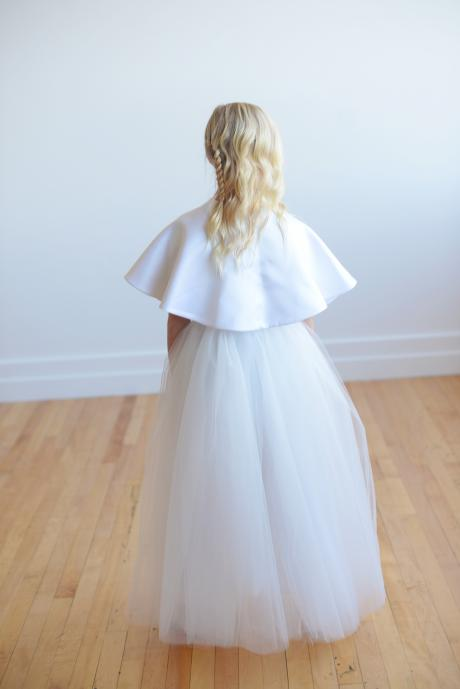 The back of our white satin flower girl cape which ties at the front in a big bow