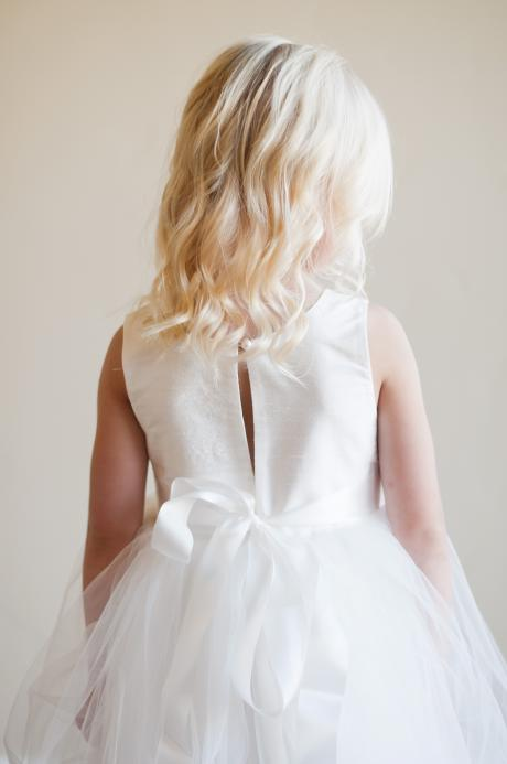 the back of the peony dress in ivory with ribbon sash