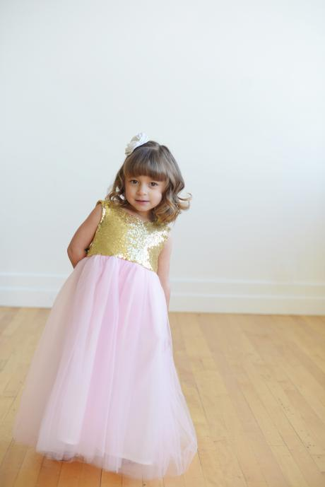A handmade gold sequin flower girl dress with pink tulle skirt and a sash in olive green.