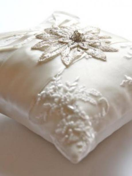 A wedding ring cushion with beads and diamanté star detail to hold wedding rings.